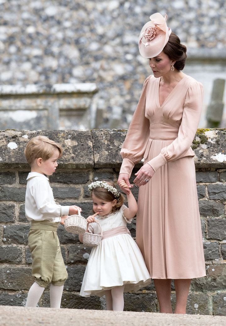 Kate with George and Charlotte at the wedding of her sister Pippa Middleton and James Matthews on 20 May 2017.