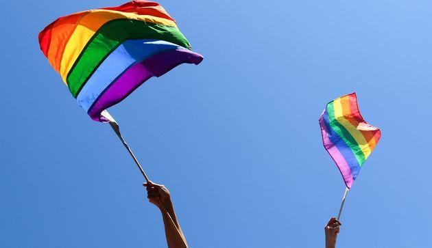 People wave rainbow