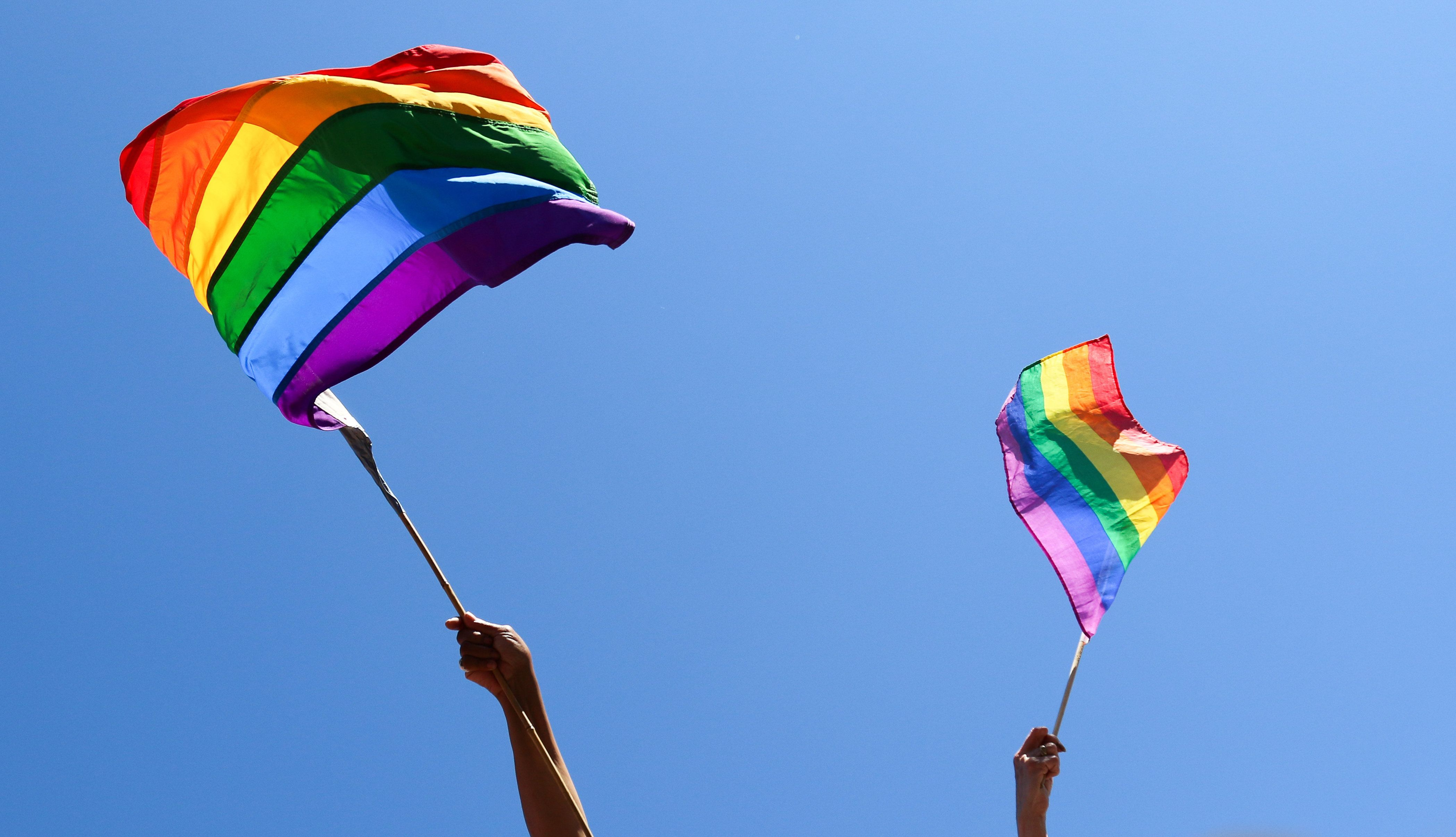 Waving rainbow flags