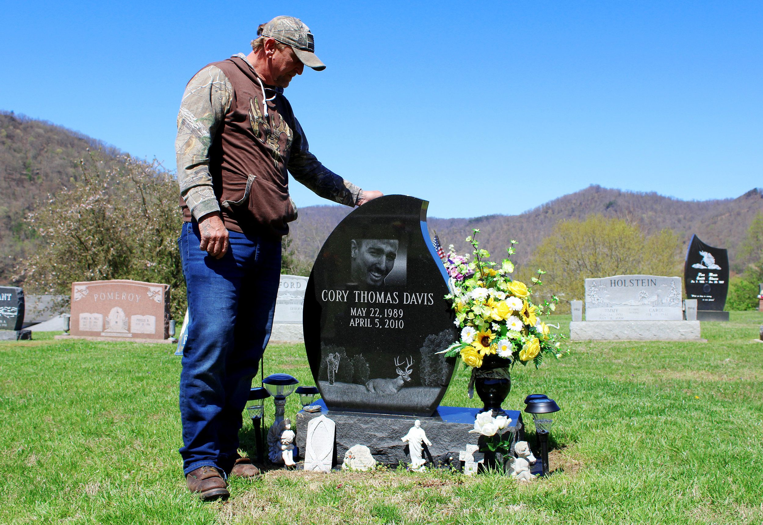 Davis visits his son's grave.