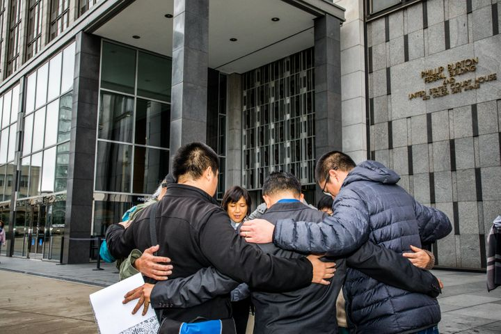 Reverend Deborah Lee prays outside the Phillip Burton Federal Building in San Francisco before attending a hearing on th