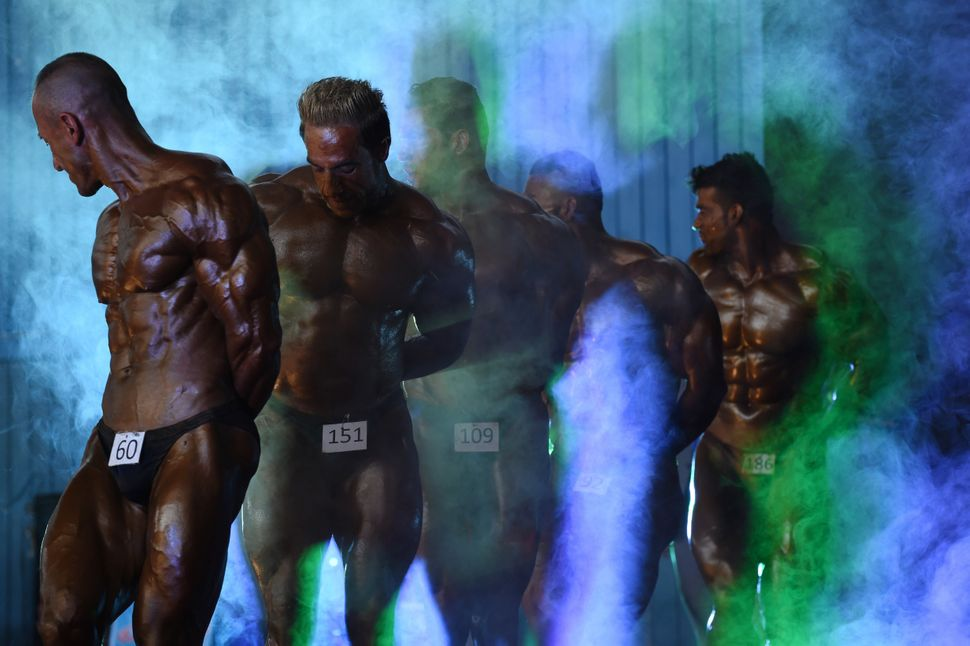 Bodybuilders participate in the Mr. Afghanistan nationwide competition in Kabul on June 3, 2015. Bodybuilding is one of
