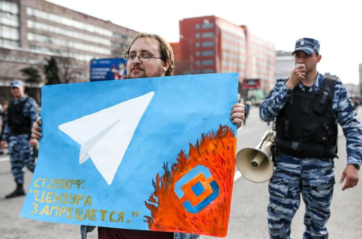 "A man holds a poster as he takes part in a rally for ""free Internet"" and in support of the Telegram Messenger in Akademika Sa"