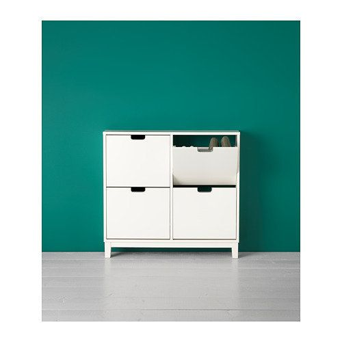 """This <a href=""""https://www.ikea.com/us/en/catalog/products/70178170/"""" target=""""_blank"""">four-compartment cabinet</a> stores&nbsp"""
