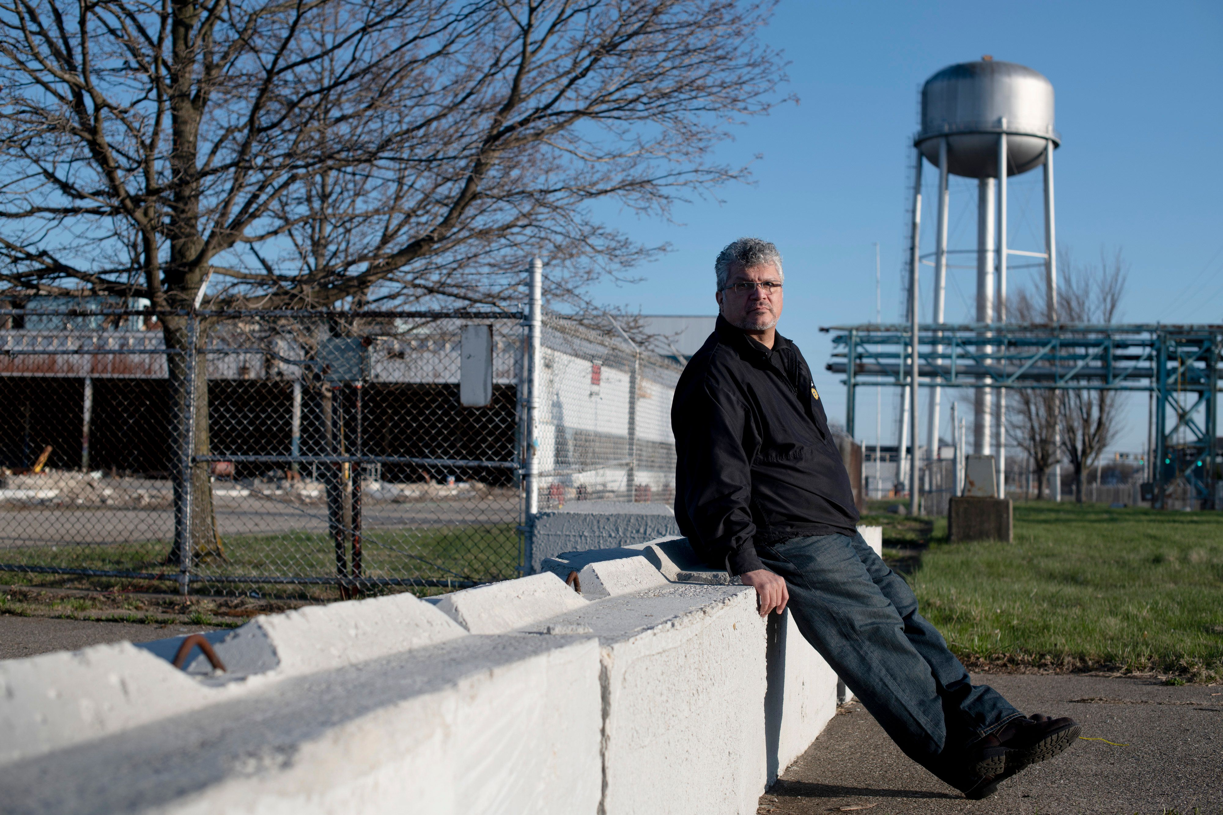 Art Reyes, an electrician at the GM Flint Assembly Plant and former president of UAW Local 651, poses on Sunday, April 29, 2018 in front of the Delphi Flint East, former AC Spark Plug building in Flint, Mich. Reyes worked in the AC Spark Plug facility for 25 years before moving to work with GM. Rachel Woolf for Huffington Post