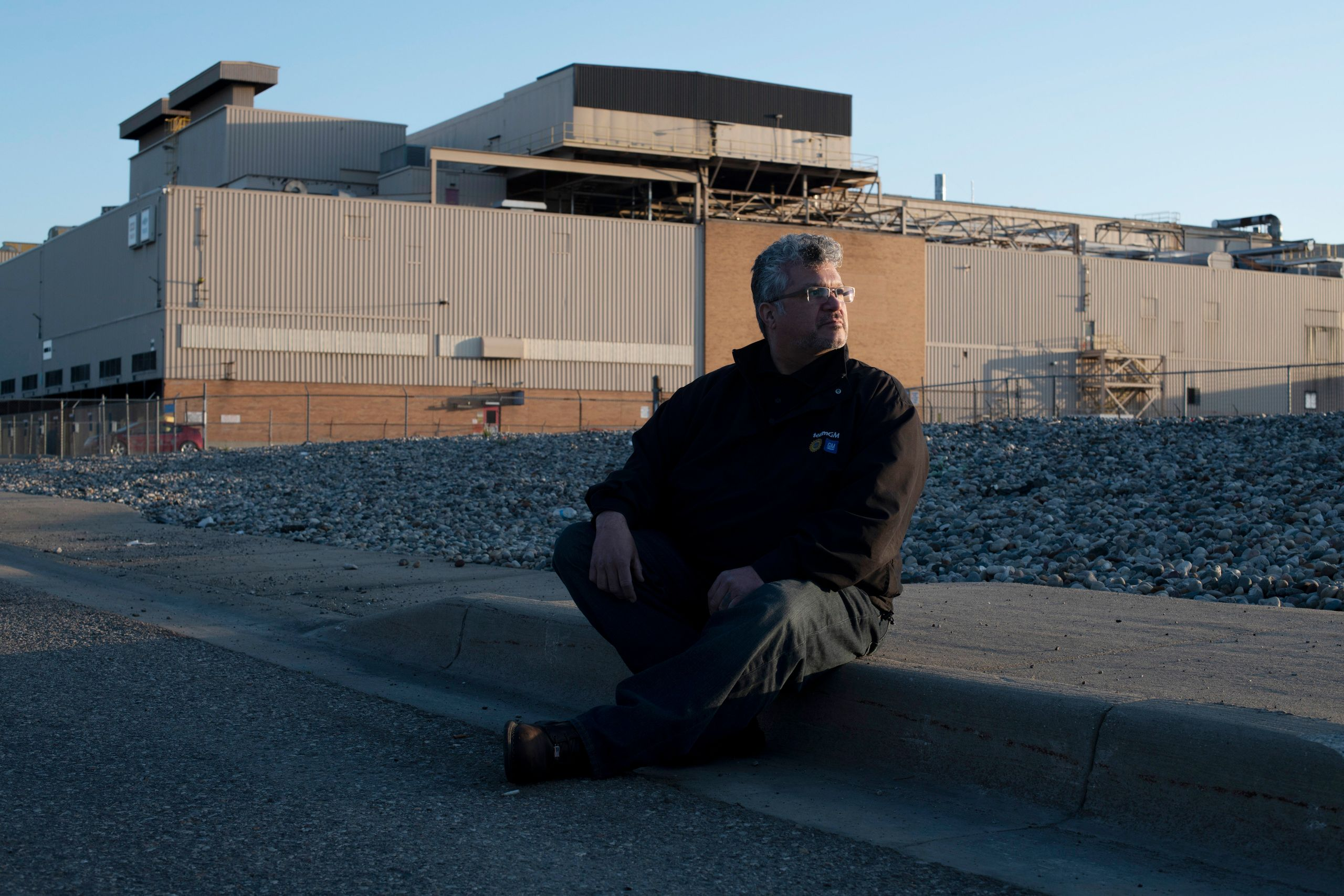 Reyes sits outside the GM Flint Assembly Plant, where he works as an electrician, April 29.