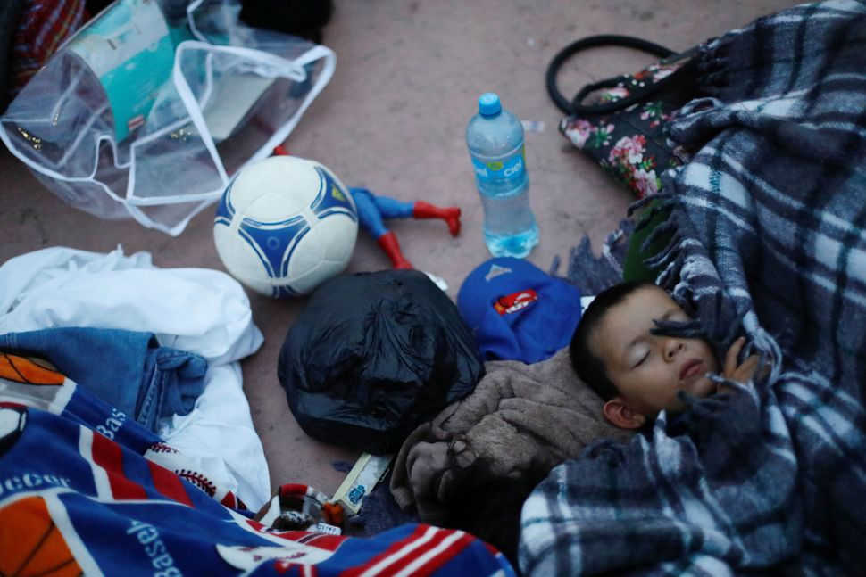 A child traveling with a caravan of migrants from Central America sleeps near the San Ysidro checkpoint.
