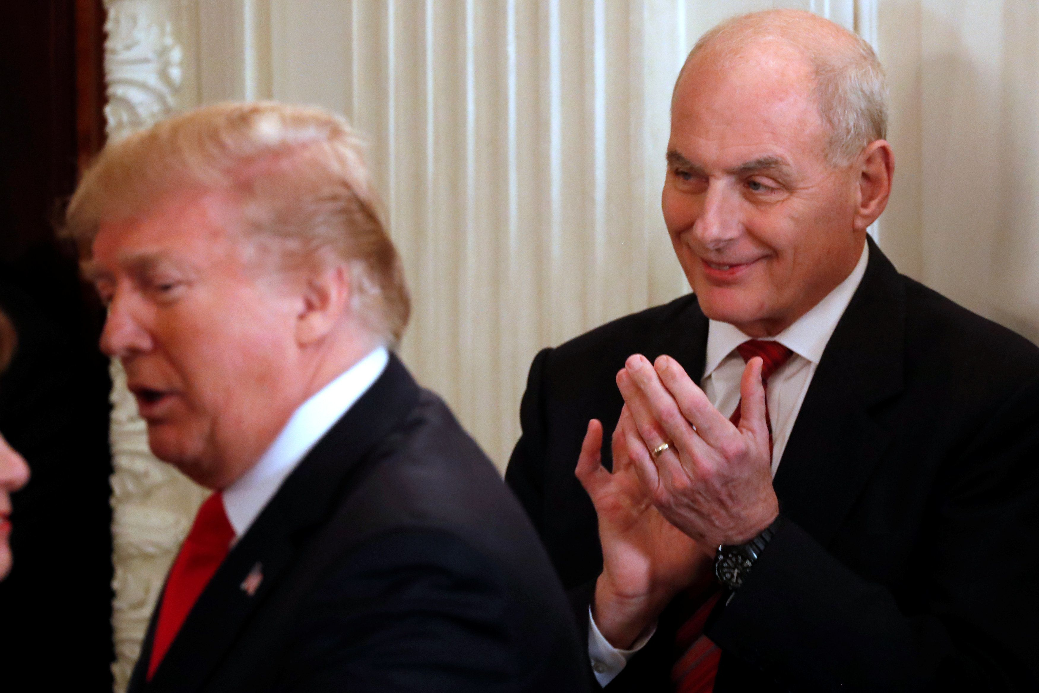 White House Chief of Staff John Kelly (R) applauds as U.S. President Donald Trump arrives to hold a discussion about school shootings with state governors from around the country at the White House in Washington, U.S. February 26, 2018.  REUTERS/Jonathan Ernst