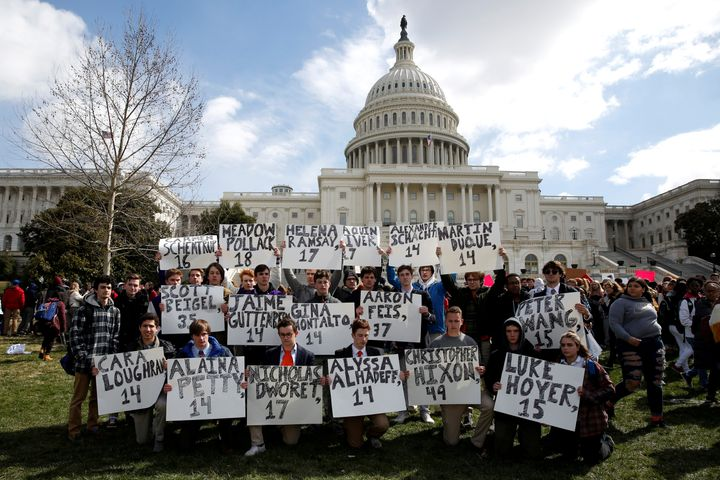 Students from Gonzaga College High School in Washington, D.C., hold up signson March 14 that have the names ofthe