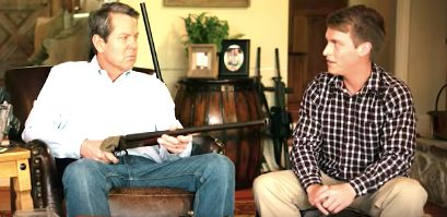Brian Kemp points a shotgun at Jake on his political ad for the governors race