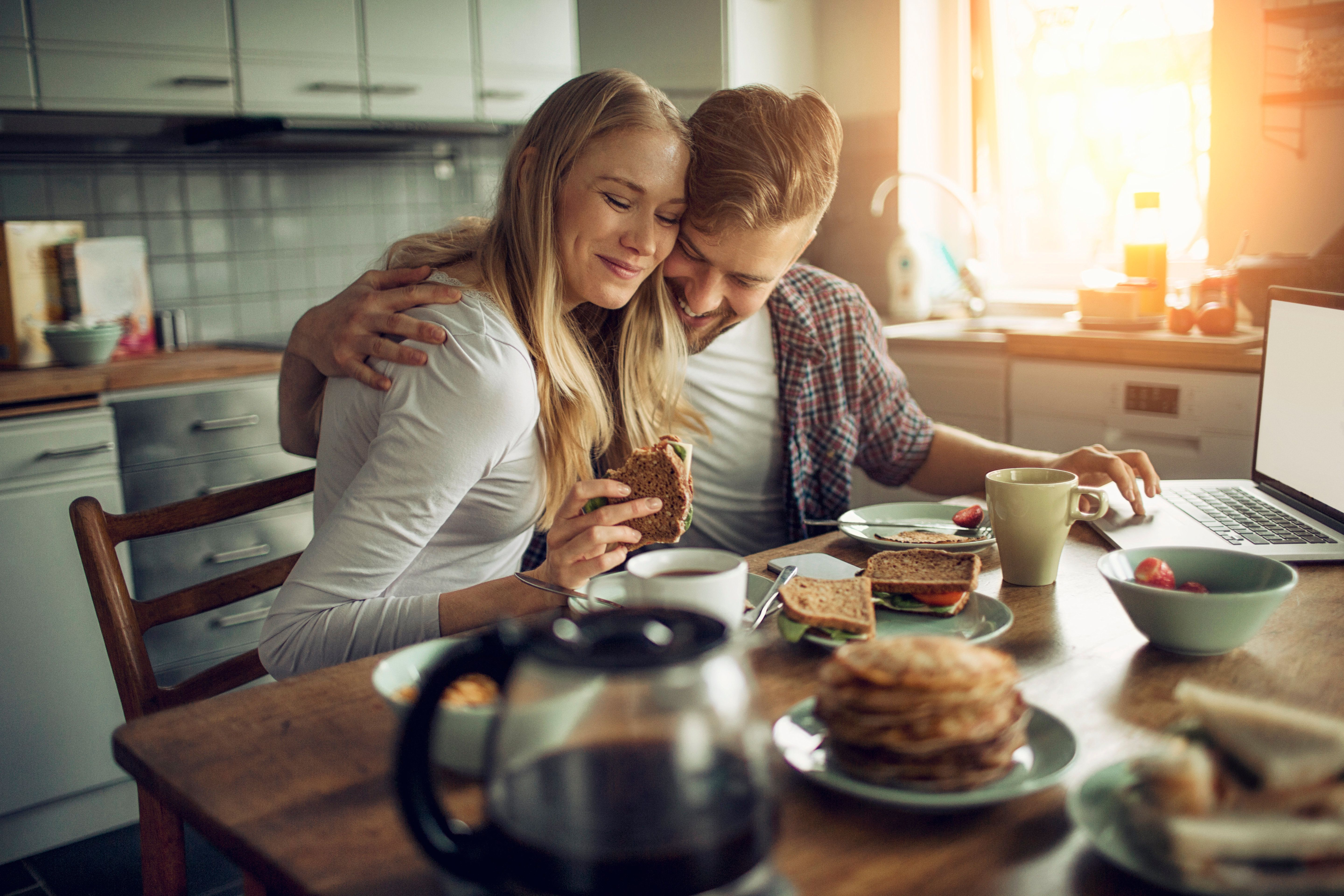 Photo of a young couple enjoying breakfast together