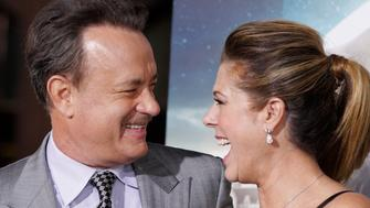 "Actor Tom Hanks, one of the stars of the new film ""Cloud Atlas,"" poses with wife, actress Rita Wilson, as they arrive for the film's premiere at Grauman's Chinese theatre in Hollywood, California, October 24, 2012.   REUTERS/Fred Prouser/File Photo"
