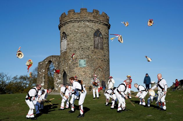 Leicester Morrismen throw their hats during May Day celebrations at Bradgate Park in Newtown Linford,