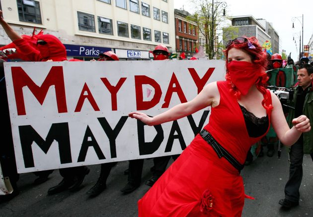 Anti-war demonstrators make their way through Brighton, East Sussex, during a past May Day