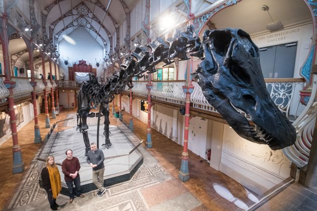 People look on at Dippy the dinosaur, a diplodocus skeleton on loan from the Natural History Museum at it is unveiled at Dorset County Museum on the first stage of an eight-stop tour of the UK on February 9, 2018 in Dorchester, Dorset.