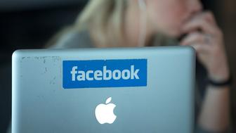 A laptop computer with the Facebook logo is seen on display at the offices of Facebook Inc.'s European headquarters at Hanover Quay in Dublin, Ireland, on Thursday, March 14, 2013. Ireland's renewed competiveness makes it a beacon for the U.S. companies such as EBay, Google Inc. and Facebook Inc., which have expanded their operations in the country over the past two years. Photographer: Simon Dawson/Bloomberg via Getty Images