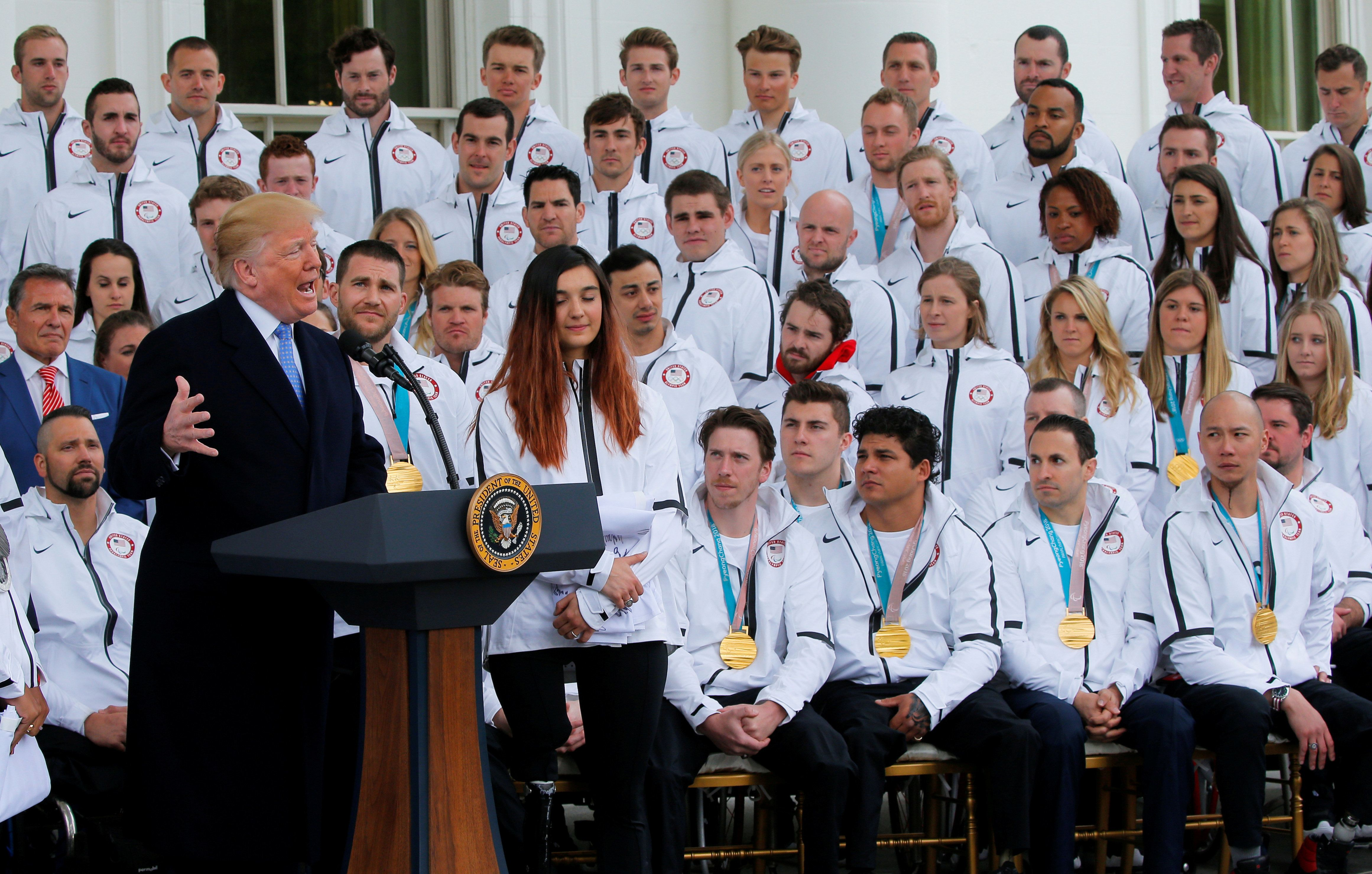 U.S. President Donald Trump gestures as he welcomes members of the 2018 U.S. Olympic and Paralympic teams to the White House in Washington, U.S., April 27, 2018. REUTERS/Brian Snyder