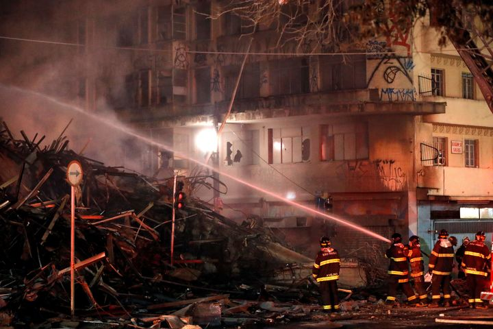 Firefighters try to extinguish a fire at a building in downtown Sao Paulo, Brazil, on May 1.