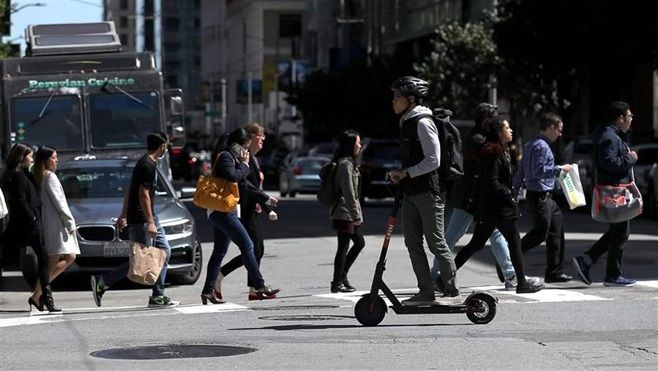 A scooter rider in San Francisco. The city's attorney sent cease-and-desist letters to scooter companies. Other cities, in th