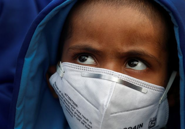 A child wears a face mask for protection from air pollution in Delhi, India November 14,