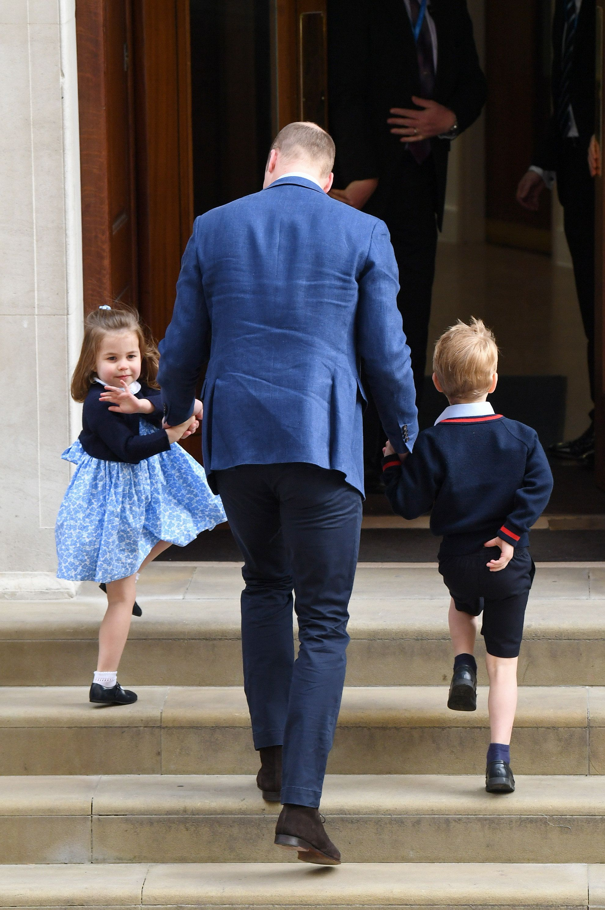 LONDON, ENGLAND - APRIL 23:  Prince William, Duke of Cambridge arrives with Prince George and Princess Charlotte at the Lindo Wing after Catherine, Duchess of Cambridge gave birth to their son at St Mary's Hospital on April 23, 2018 in London, England. The Duchess safely delivered a boy at 11:01 am, weighing 8lbs 7oz, who will be fifth in line to the throne..  (Photo by Samir Hussein/WireImage)