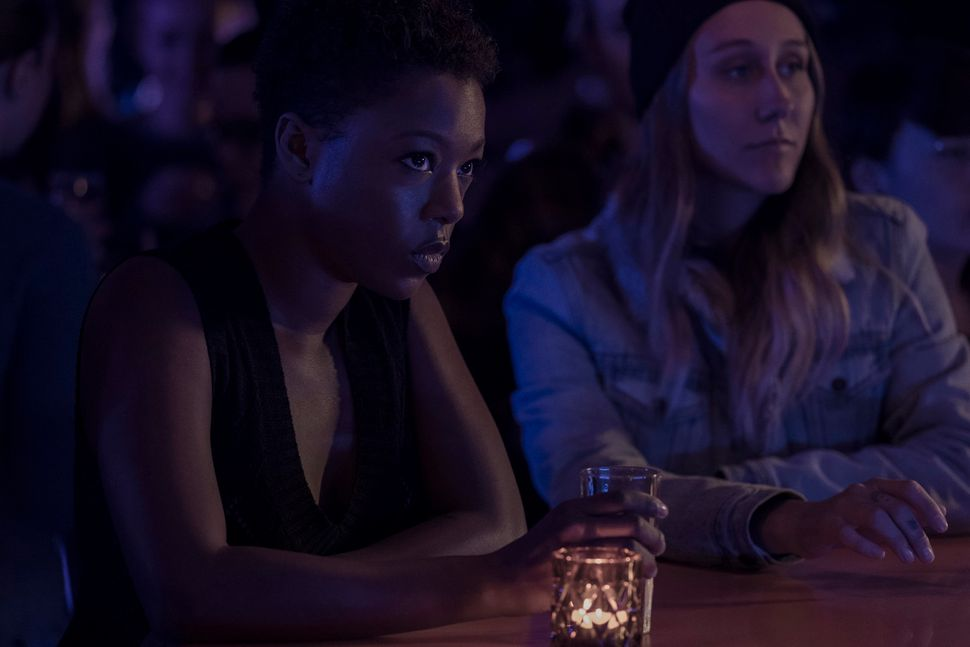 Moira (left, Samira Wiley) at a lesbian bar in Canada.