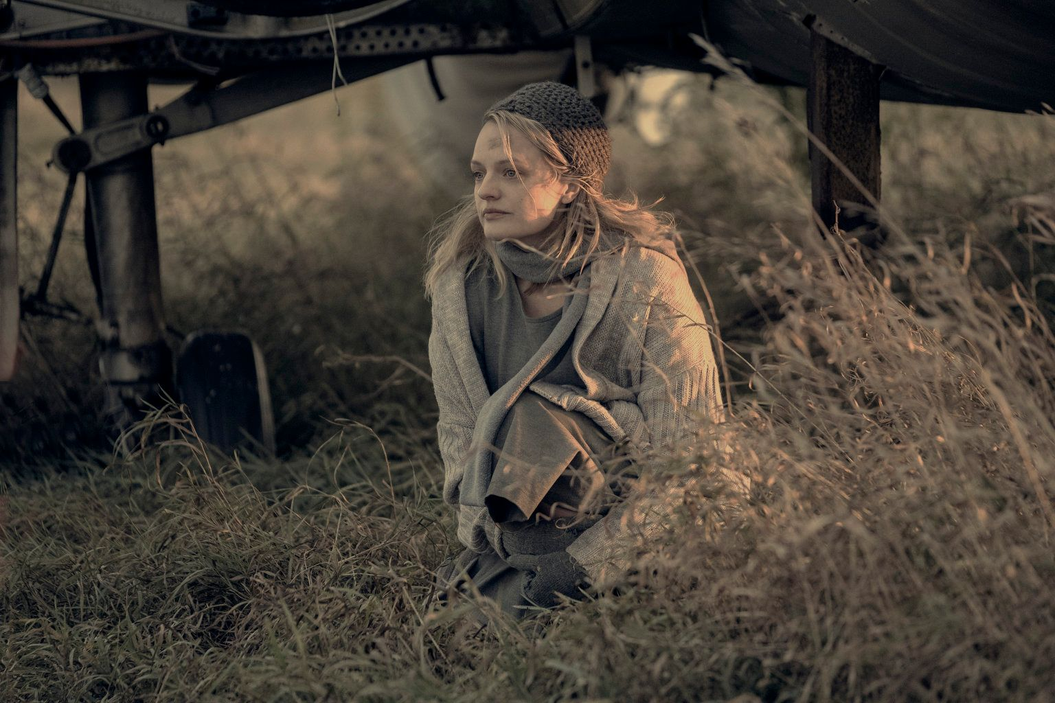 """June (Elisabeth Moss) waits at an airstrip as she tries to escape Gilead for Canada in """"The Handmaiden'sTale."""""""
