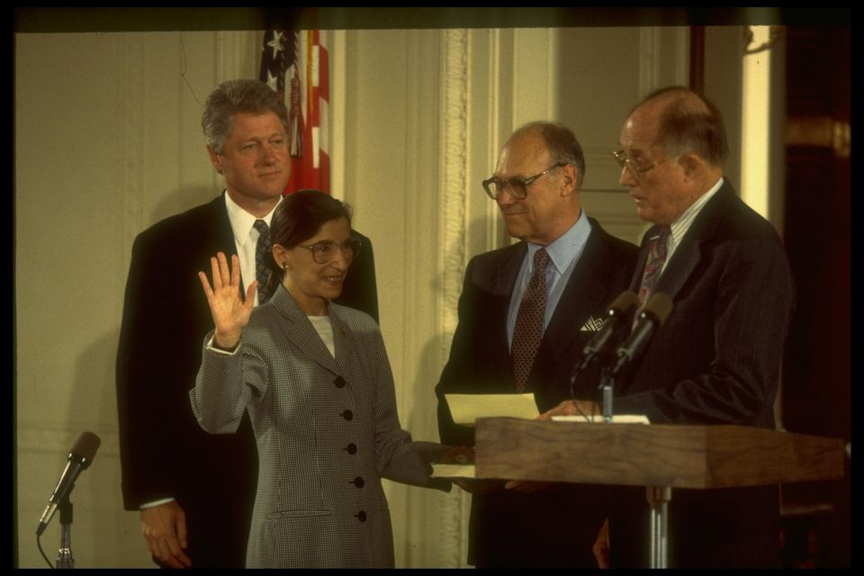 Chief Justice William Rehnquist (right) swears in Ginsburg to the Supreme Court in 1993 as husband Marty...