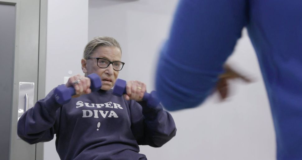 "Ginsburg works out in a scene from ""RBG."""