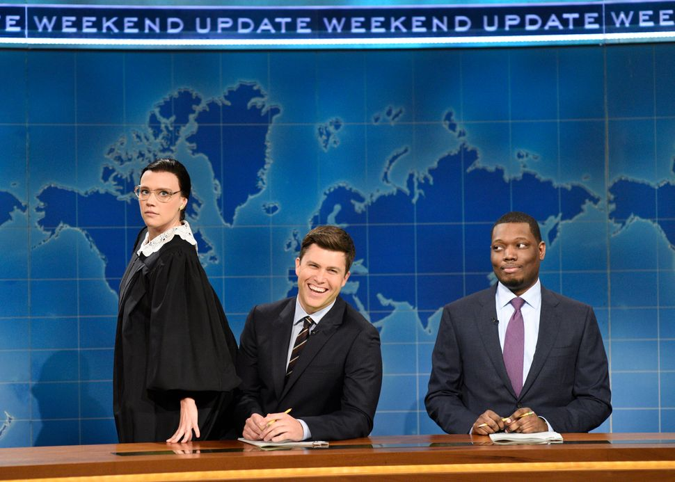 "From left, Kate McKinnon as Ginsburg with Colin Jost and Michael Che during ""Saturday Night Live"" on Oct. 7, 2017."