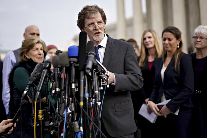 Jack Phillips (center), theowner of Masterpiece Cakeshop, speaks to members of the media in Washington, D.C., on Dec. 5