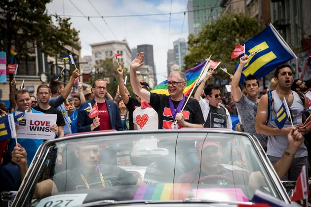 Supreme Court plaintiff Jim Obergefell rides in a convertible in the San Francisco Gay Pride Parade on...