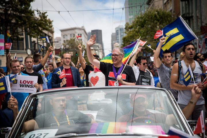 Supreme Court plaintiff Jim Obergefell rides in a convertible in the San Francisco Gay Pride Parade on June 28, 2015. Obergef