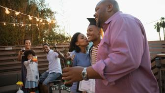Affectionate African American parents celebrating son