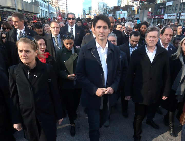 Canadian Prime Minister Justin Trudeau, Governor General Julie Payette and Toronto Mayor John Tory walk to a vigil for t