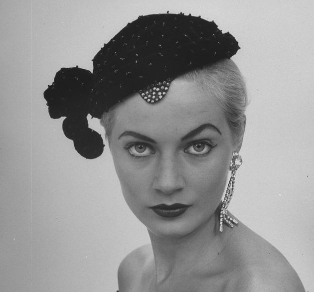 Swedish model Anita Ekberg wearing a beaded cocktail hat in the