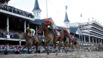 May 6, 2017; Louisville , KY, USA; Flavien Prat aboard Battle of Midway (11) races to the finish of the 2017 Kentucky Derby at Churchill Downs. Mandatory Credit: Brian Spurlock-USA TODAY Sports