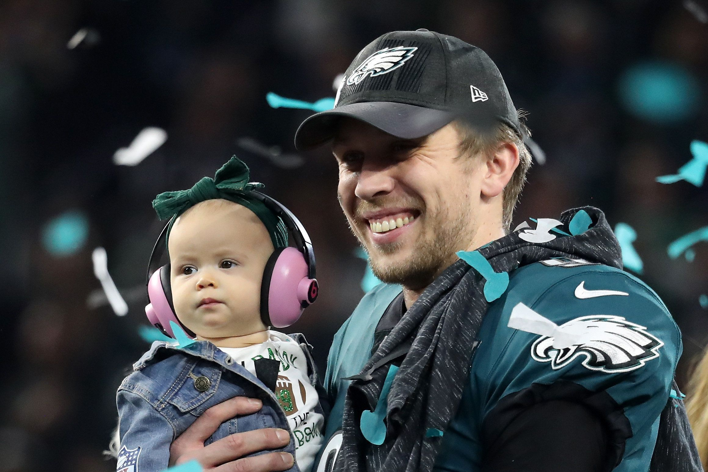 MINNEAPOLIS, MN - FEBRUARY 04:  Nick Foles #9 of the Philadelphia Eagles celebrates with his daughter Lily Foles after his 41-33 victory over the New England Patriots in Super Bowl LII at U.S. Bank Stadium on February 4, 2018 in Minneapolis, Minnesota. The Philadelphia Eagles defeated the New England Patriots 41-33.  (Photo by Rob Carr/Getty Images)