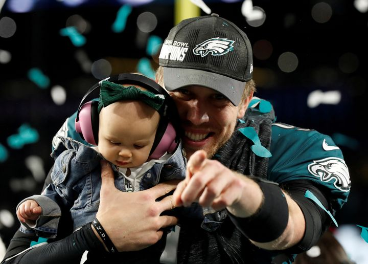 Nick Foles celebrates with daughter Lily after the Philadelphia Eagles win the Super Bowl on Feb. 4.