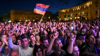 TOPSHOT - Supporters of Armenian opposition leader Nikol Pashinyan gesture as they attend a rally in downtown Yerevan on May 1, 2018. - Armenian leader Nikol Pashinyan on May 1, 2018 called on his supporters to launch a campaign of civil disobedience and block key transport links including an airport after he failed in his bid to get elected prime minister. (Photo by Vano Shlamov / AFP)        (Photo credit should read VANO SHLAMOV/AFP/Getty Images)
