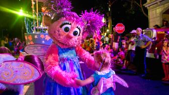 LANGHORNE, PA - AUGUST 4: Abby Cadabby finds a look-alike to dance with along the parade route at Sesame Place Thursday, Aug.4, 2011 in Langhorne, PA. Photo by Katherine Frey/The Washington Post via Getty Images)