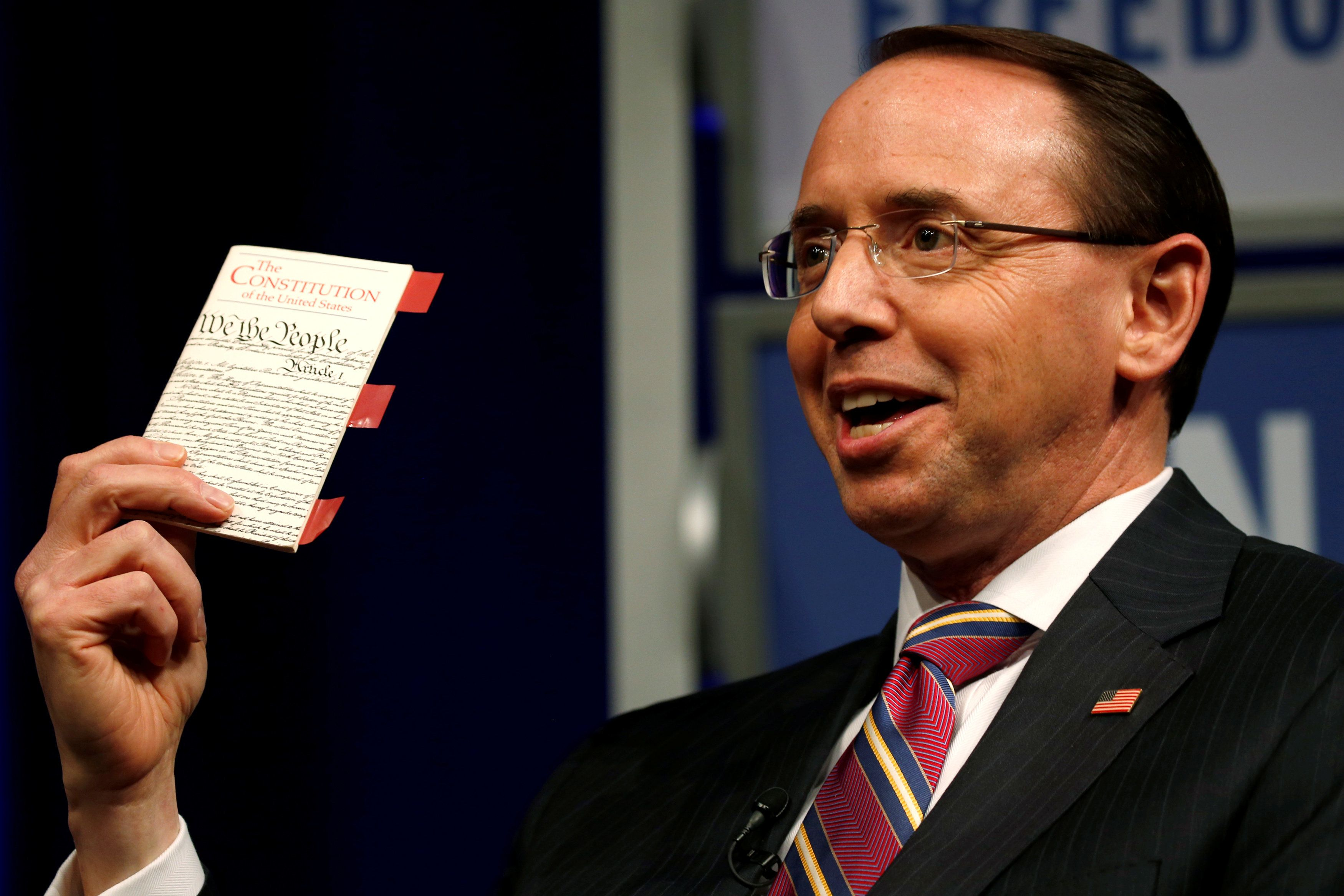Deputy U.S. Attorney General Rod Rosenstein holds his copy of the U.S. Constitution as he participates in a Law Day event at the Newseum in Washington, U.S. May 1, 2018.  REUTERS/Jonathan Ernst