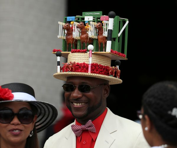 A patron wears a decorated derby hat before thederby in 2016.