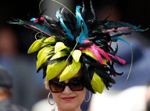 A woman wears a fancy hatat the 2012 derby.