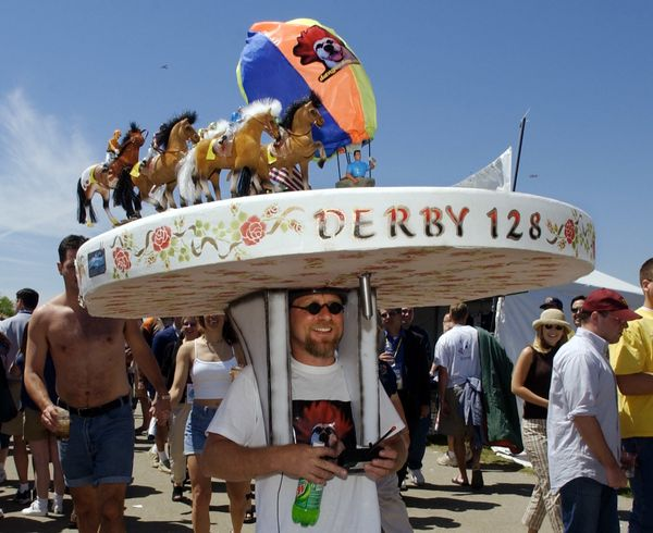 Tony Offluttof New Albany, Indiana, wears a huge derby-themed hat at Churchill Downs on May 4, 2002.