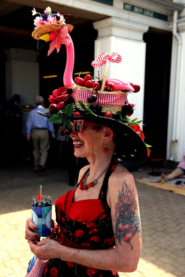 A woman wearing a festive hat looks at the 2015derby.