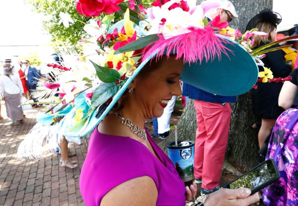 A woman wearing a festive hat looks on ahead of the 2017derby.
