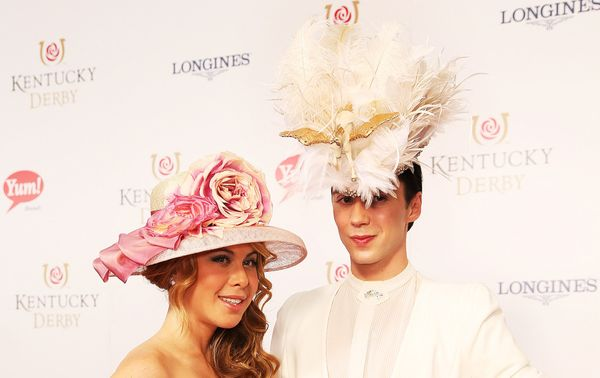 Former ice skaters Tara Lipinski and Johnny Weir arrive on the red carpet before the Kentucky Derby in 2014.