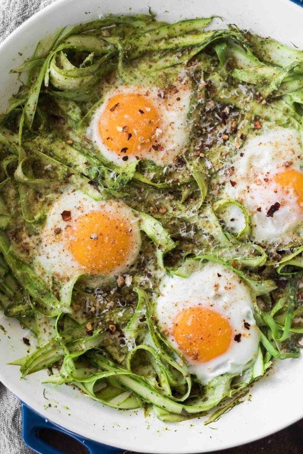 "<strong>Get the <a href=""https://naturallyella.com/pesto-asparagus-egg-skillet/"" target=""_blank"">Pesto Asparagus Egg Skillet<"