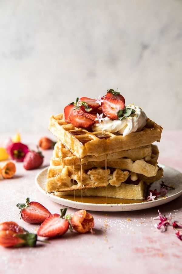 "<strong>Get the <a href=""https://www.halfbakedharvest.com/overnight-waffles-with-whipped-meyer-lemon-cream-and-strawberries/"""